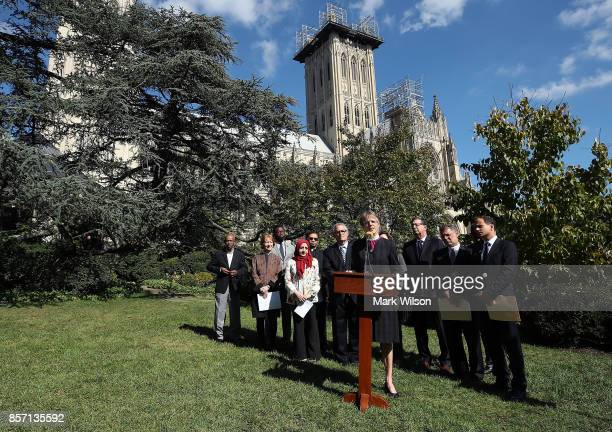 Rev Mariann Budde Bishop of the Episcopal Diocese of Washington speaks while flanked by a group of local religious leaders from many faiths during a...