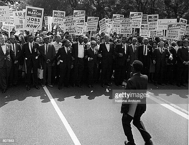Rev Martin Luther King and other civil rights leaders march at a civil rights rally August 28 1963 in Washington
