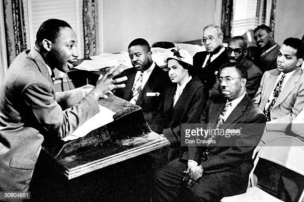 Rev Martin Luther King director of segregated bus boycott brimming w enthusiasm as he outlines boycott strategies to his advisors organizers incl Rev...