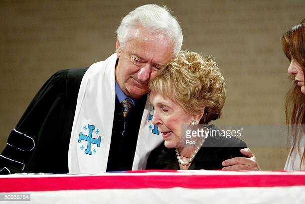 Rev Michael Wenning consoles former first lady Nancy Reagan over the casket that contains the body of former US President Ronald Reagan inside the...