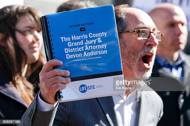 Rev. Patrick Mahoney holds a petition while speaking to the media before David Daleiden, a defendant in a Planned Parenthood video speaks at the...