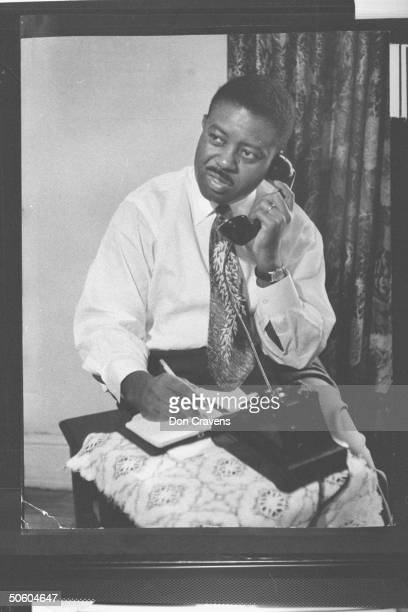 Rev Ralph Abernathy coorganizer of segregated bus boycott talking on telephone during time of protest over the policy of forcing African Americans to...