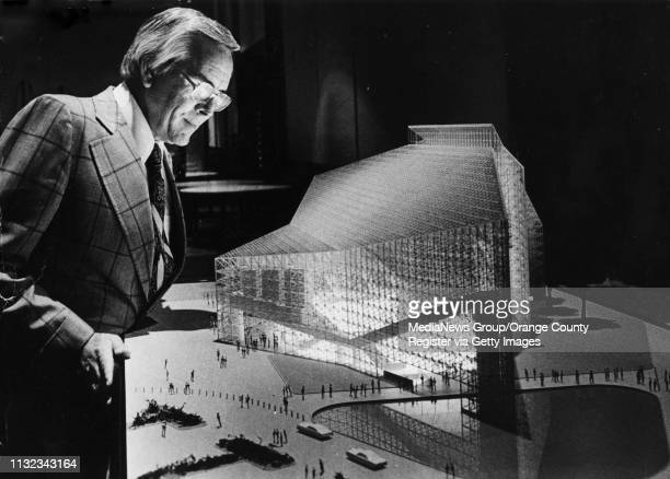 Rev. Robert H. Schuller looks over a model of the future Crystal Cathedral in Garden Grove, CA. Photo circa mid-1970's.