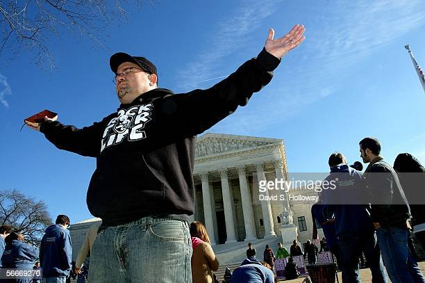 Rev Steve Dornbusch raises his hands in prayer during a March for Life prayer vigil in front of the Supreme court building on January 22 2006 in...