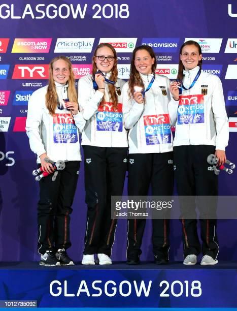 Reva Foos Isabel Marir Gose Sarah Koehler and Annika Bruhn of Germany celebrate their bronze medal on the podium following the women's 4x200m...