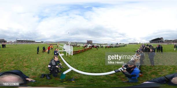 Reve de Sivola leads the field in the Ladbrokes World Chase during St Patrick's Thursday at Cheltenham racecourse on March 14 2013 in Cheltenham...