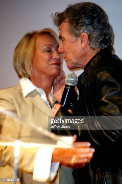 Reve Walsh and husband John Walsh embrace during their speech to the audience at America's Most Wanted Night of a Thousand Captures on May 14 2008 at...