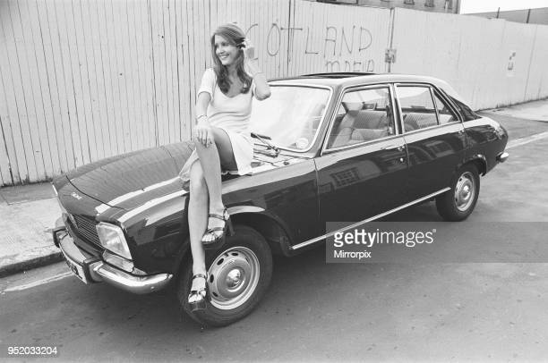 Reveille model Beulah Hughes seen here posing with a Peugeot 504 car which is a top prize in the Reveille win a car competition circa 1973