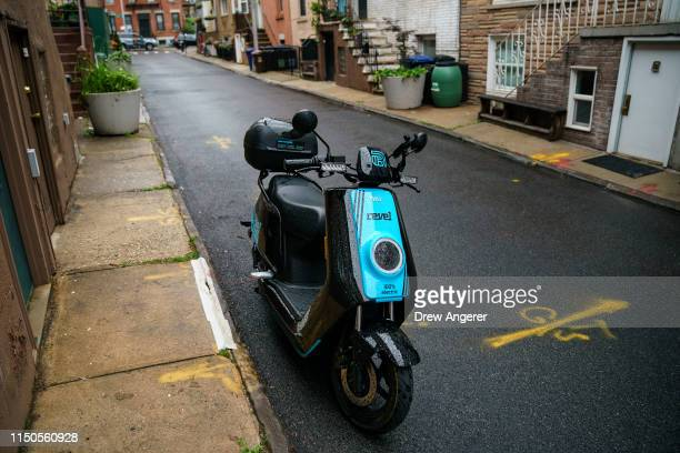 Revel brand moped sits parked on a residential street June 18 2019 in the Brooklyn borough of New York City The rideshare moped company has deployed...