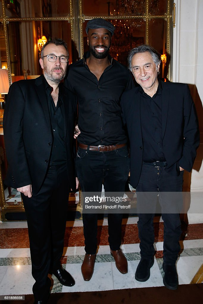 Revelation for 'Tout, tout de suite', Steve Achiepo standing between his sponsor Fred Cavaye and his director Richard Berry attend the 'Cesar - Revelations 2017' Dinner at Hotel Meurice on January 16, 2017 in Paris, France.