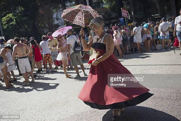 Reveler dances in the street during the Bloco das Mulheres Rodadas Carnival parade in Rio de Janeiro, Brazil, on Wednesday, Feb. 10, 2016. The Bloco...