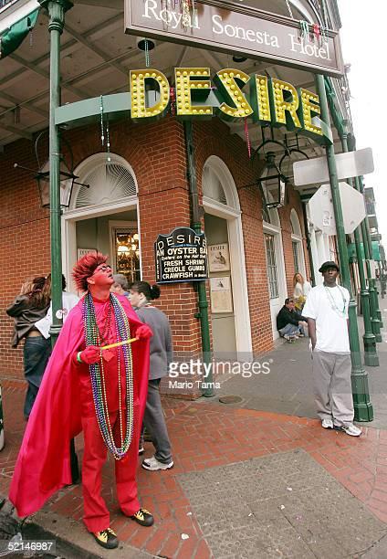 A reveler dressed as the Devil stands on Bourbon Street during Mardi Gras festivites February 6 2005 in New Orleans Louisiana Festivities will...