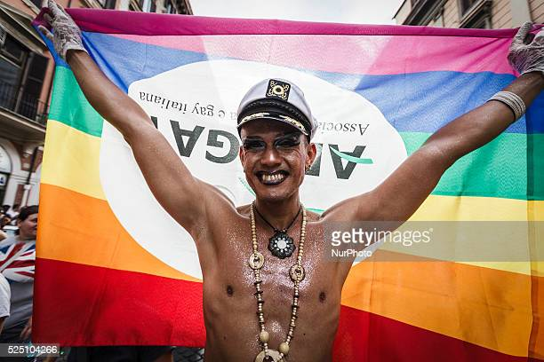 A reveler holds a rainbow flag during the 21st annual Gay Pride Parade in Rome Italy on June 13 2015 Tens of thousands of members of Italian LGBTQI...