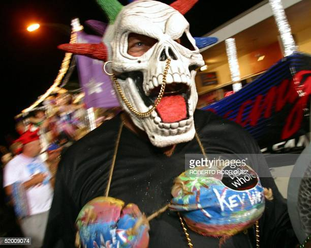 A reveler in a rather bizarre costume walks down Duval Street during the Fantasy Fest Parade late 26 October 2002 in Key West Florida More than 60000...