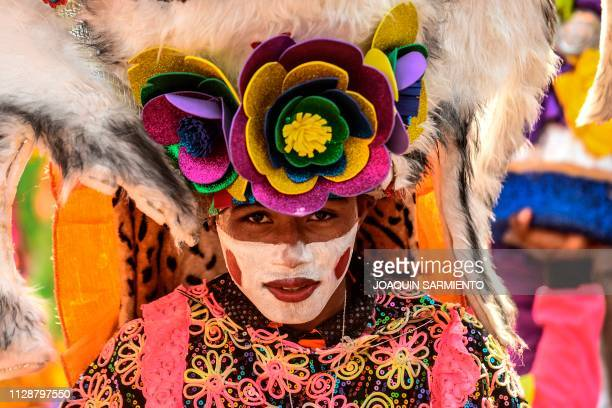 Reveler is pictured during a carnival parade in Barranquilla, Colombia on March 5, 2019.