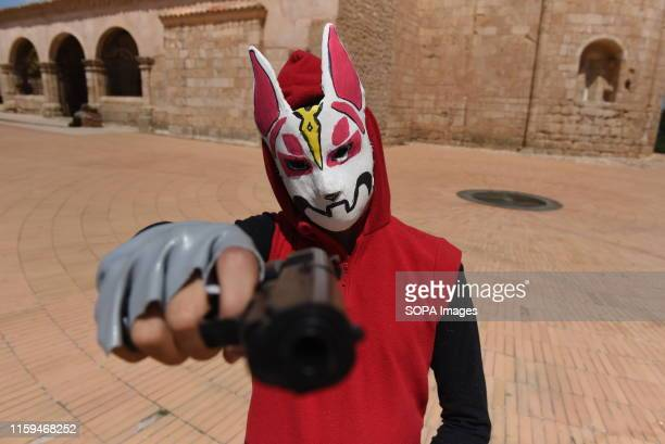 A reveler is seen posing for a picture during the festival Hundreds of revellers celebrate the XV La Juventud festival in Almazán north of Spain...