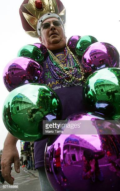 A reveler is wears giant beads on Bourbon Street during Mardi Gras festivites February 6 2005 in New Orleans Louisiana Festivities will continue all...