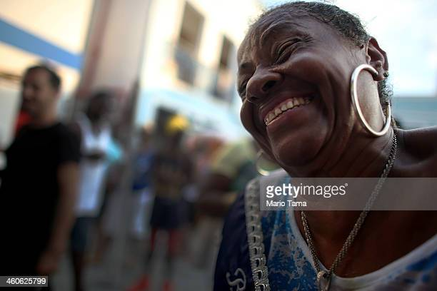 A reveler laughs while posing at a traditional samba and feijoada party held at the Portela Samba School in the Madureira neighborhood during...