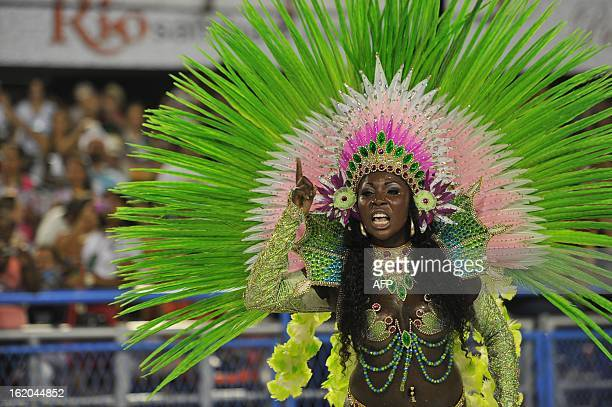 A reveler of Mangueira samba school performs during the second night of Carnival parades at the Sambadrome in Rio de Janeiro on February 11 2013 AFP...