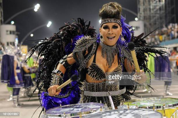 A reveler of Mocidade Alegre samba school performs during the second night of carnival parades at the Sambadrome in Sao PauloBrazil on February 10...
