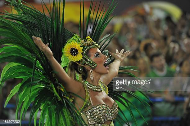 A reveler of Vila Isabel samba school performs during the second night of Carnival parades at the Sambadrome in Rio de Janeiro on February 12 2013...