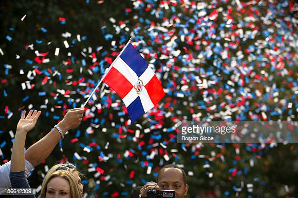 A reveler on one of the Duck Boats in the parade waved a Dominican Republic flag Designated hitter David Ortiz is Dominican Red Sox fans lined...