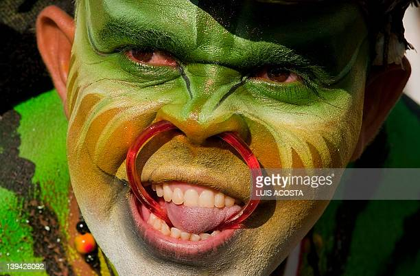 A reveler performs during the third day of carnival parade in Barranquilla Colombia on February 20 2012 Barranquilla's carnival a tradition cretaed...