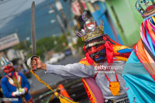 Reveler performs during the traditional Historiantes dance as part of international Indigenous day amid Coronavirus pandemic on August 9 2020 in San...