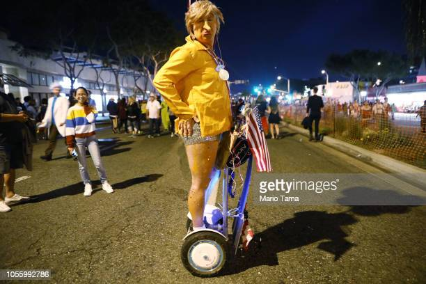 A reveler poses as President Donald Trump at the annual Hollywood Carnaval street party on October 31 2018 in West Hollywood California More than...