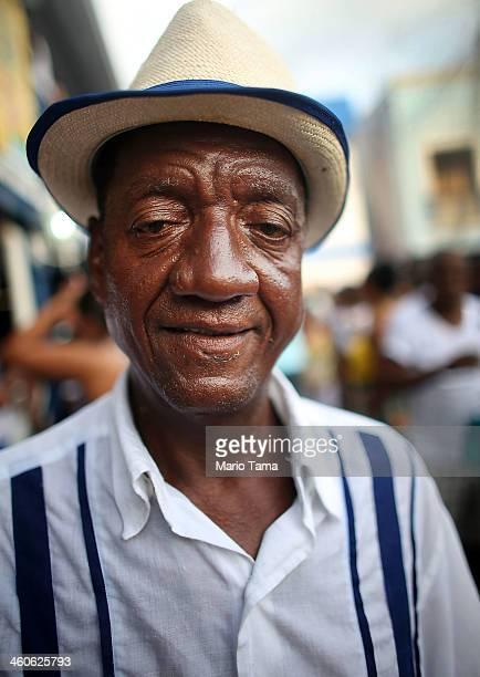 A reveler poses at a traditional samba and feijoada party held at the Portela Samba School in the Madureira neighborhood during preCarnival...
