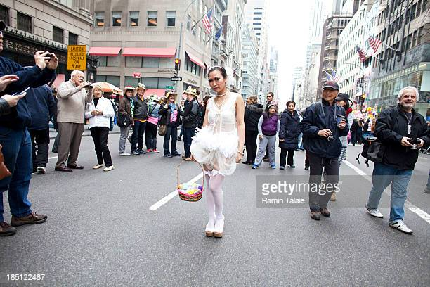 A reveler poses for pictures during the annual Easter Day procession on 5th Avenue March 31 2013 in New York City The annual festivities attracts...
