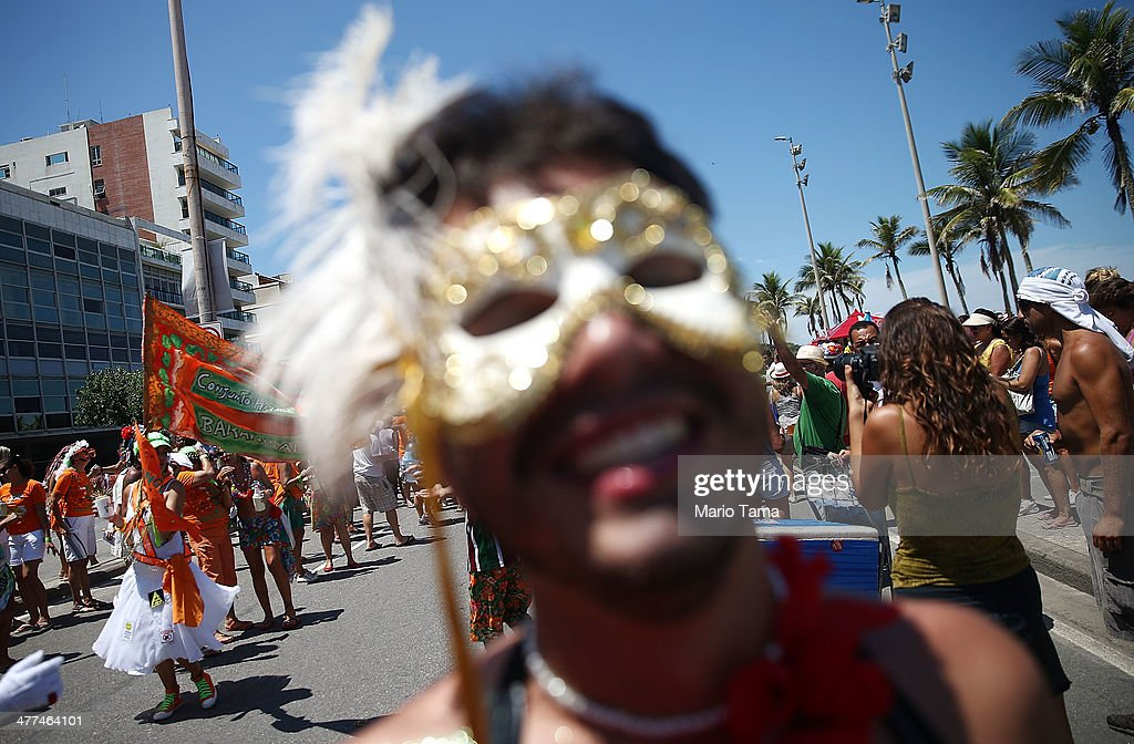 A reveler poses while celebrating during a street carnival 'bloco' on March 9, 2014 in Rio de Janeiro, Brazil. While Carnival officially ended earlier this week, street carnival parades continued through today in Rio.