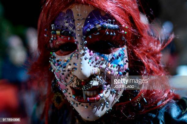 A reveler wearing several face piercings parades during Sitges Gay Carnival on February 13 2018 in Sitges near Barcelona / AFP PHOTO / Josep LAGO