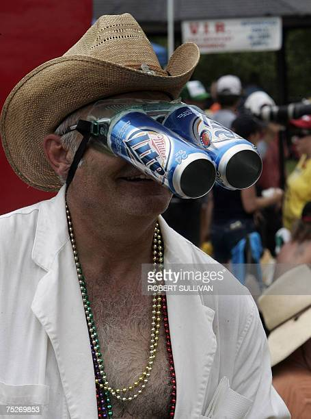 A reveler wears his homemade beer can goggles 07 July 2007 during the 2007 Redneck Games in East Dublin Georgia The daylong yearly festival...