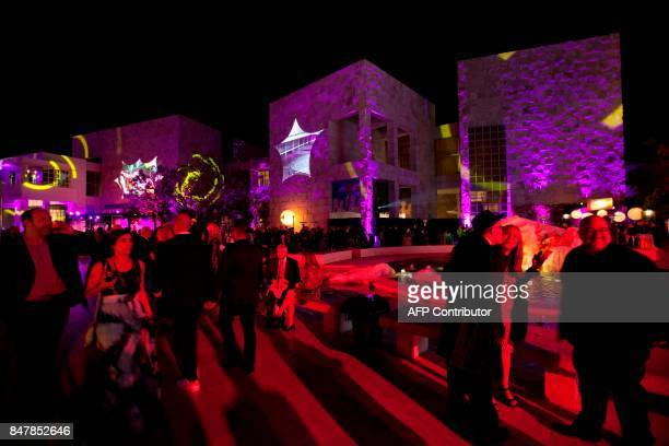 Revelers and artists attend the opening of the Pacific Standard Time: LA/LA event at the Getty Museum in Los Angeles late on September 15, 2017....