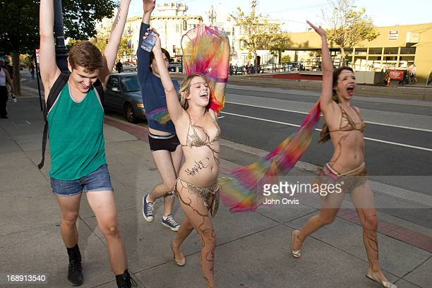 CONTENT] Revelers at San Francisco Pride weekend raise their hands in unison as they walk down Market St near the Castro District