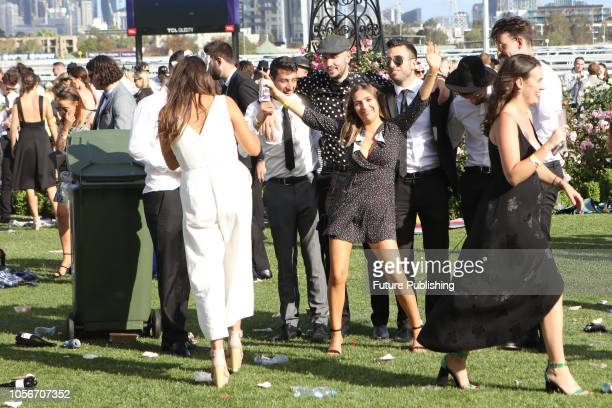 Revelers at the end of a long Derby Day at the 2018 Melbourne Cup Carnival