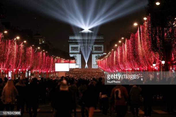 Revelers begin to gather at the Arc de Triomphe at the top of the ChampsElysees as the French capital Paris gears up for New Year's Celebrations...
