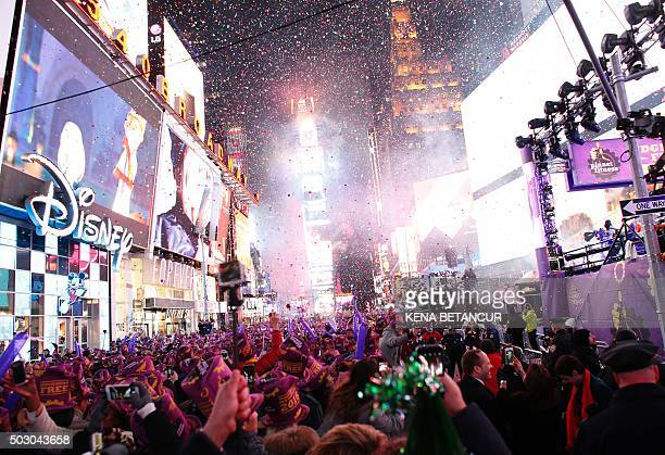 TOPSHOT Revelers celebrate after the ball drop during New Year's Eve celebrations in Times Square on January 1 2016 in New York AFP PHOTO/ KENA...