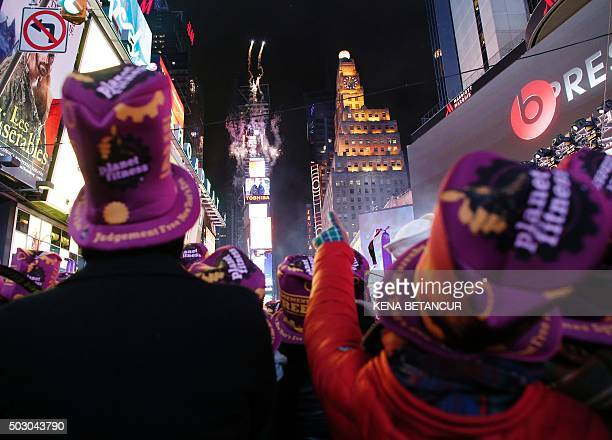 Revelers celebrate after the ball drop during New Year's Eve celebrations in Times Square on January 1 2016 in New York AFP PHOTO/ KENA BETANCUR /...