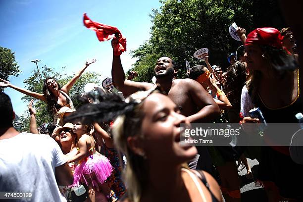Revelers celebrate at a 'bloco' street party during preCarnival festivities on February 23 2014 in Rio de Janeiro Brazil Carnival officially begins...