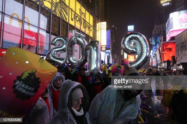 Revelers celebrate before the ball drop during New Year's Eve celebrations in Times Square on January 1 2019 in New York The New York City Police...
