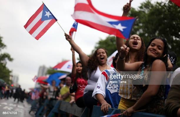 Revelers celebrate during the 116th Street Festival in Spanish Harlem June 13 2009 in New York City The 28block festival draws around 100000 Latinos...