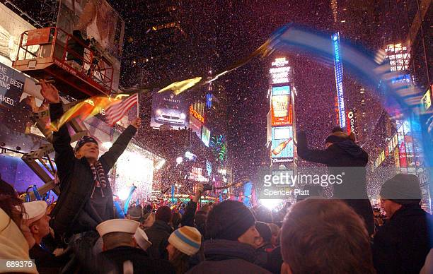 Revelers celebrate moments after the ball dropped January 1 2002 in New Yorks Times Square on New Years Eve An estimated 500000 people crowded Times...