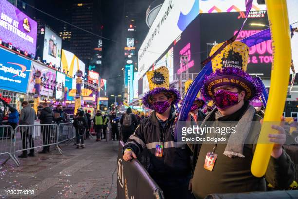 Revelers celebrate New Years Eve in socially distanced pods at Times Square on December 31 in New York City. On average, about one million revelers...