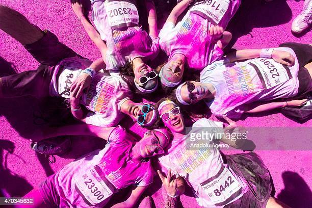 Revelers celebrate their arrival throwing colorful chalk powder after taking part in the 2nd Parisian edition of the 'Color Run' in Paris France on...