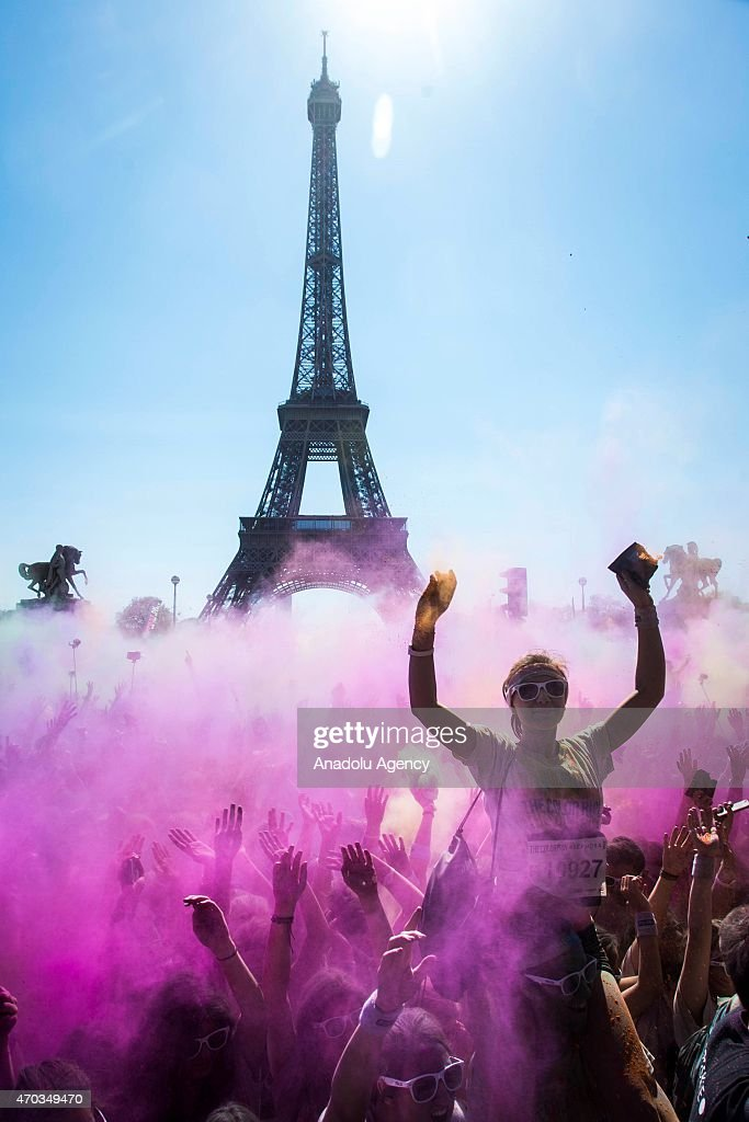 Revelers celebrate their arrival throwing colorful chalk powder after taking part in the 2nd Parisian edition of the 'Color Run' in Paris, France on April 19, 2015. The initiative takes place in cities around the world.