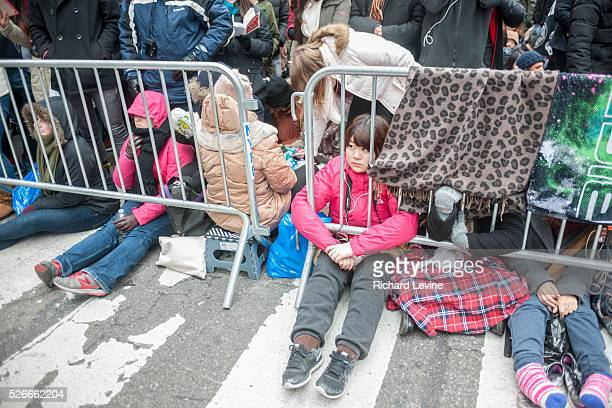 Revelers cram into pens in Times Square in New York hours before the New Year'e Eve ball drop on Thursday December 31, 2015. Over one million people...