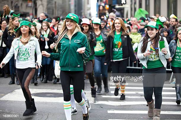 Revelers cross Fifth Avenue during the 252nd annual St Patrick's Day Parade March 16 2013 in New York City The parade honors the patron saint of...