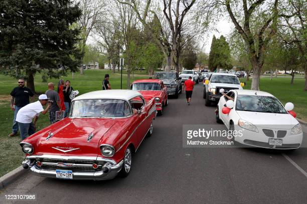 Revelers cruise through Mineral Palace Park in celebration of Cinco de Mayo on May 05, 2020 in Pueblo, Colorado. Most traditional observations of...